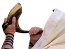 Man blowing Shofar horn